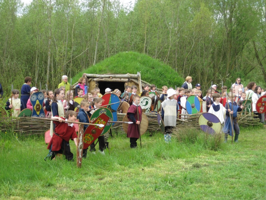 Turfed roundhouse with children in costume